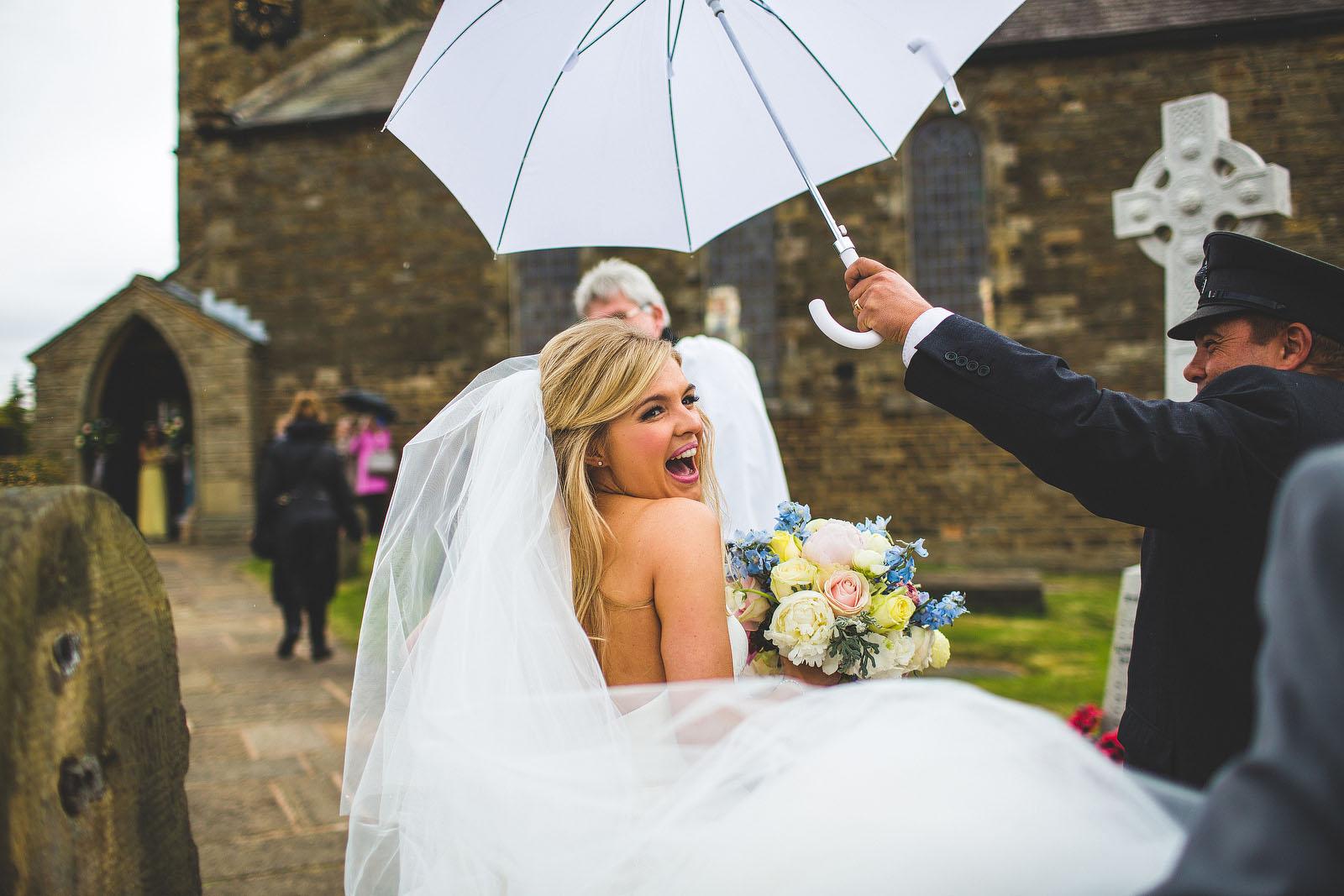 Happy bride in rain1